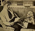 Wallace Reid reading with his dog.jpg