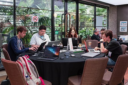 Workgroups during the hackathon, Wikimania 2014-2.jpg