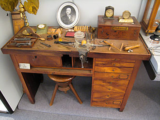Omega SA - The workbench of Louis Brandt with a photograph of the founder