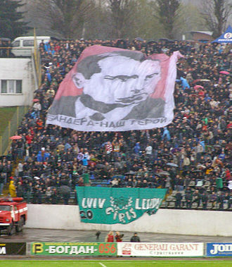 "Ukrainian nationalism - Lviv football fans at a game vs. Donetsk. The banner reads ""Bandera - our hero"""
