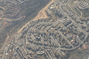 Neve Yaakov - Aerial view of Neve Yaakov, with the Mir Forest and Pisgat Ze'ev North to the left
