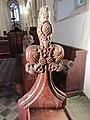 -2018-12-10 Carved bench end, Saint Margaret of Antioch parish church, Suffield, Norfolk.JPG