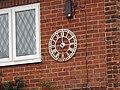 -2019-10-07 Clock face on a house on High Street, Mundesley.JPG
