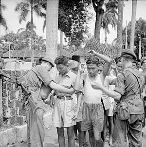 12th (Yorkshire) Parachute Battalion - Men of the 12th Battalion, Parachute Regiment search suspects in Batavia during the operation to take control of all civil administration buildings in the city.