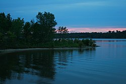 2008-08-24 Ripples on Falls Lake at sunset.jpg