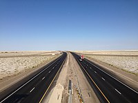 2014-07-05 18 39 41 View east along Interstate 80 from the Exit 4 overpass in the Bonneville Salt Flats, Utah.JPG