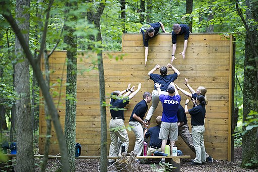 2015 Law Enforcement Explorers Conference team scaling a wall