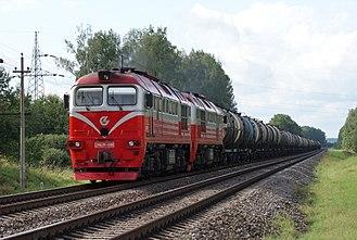 Diesel locomotive - Twin-section diesel locomotive 2M62M-1198 (rebuilt with CAT engines), near Kyviškės, Lithuania.