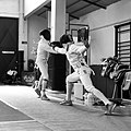 2nd Leonidas Pirgos Fencing Tournament. The fencer on the right performs a lunge during the parry of his opponent.jpg