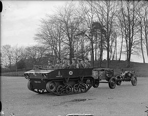 I Brigade, Royal Horse Artillery - Light Dragon tractor towing a 3.7 inch howitzer on Carriage Mk IV and limber of A Battery (The Chestnut Troop) Royal Horse Artillery.
