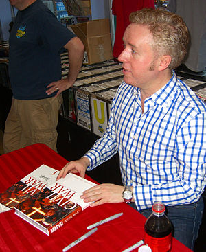 Civil War (comics) - Writer Mark Millar signing copies of the collectors edition of the main miniseries during an appearance at Midtown Comics in Manhattan.