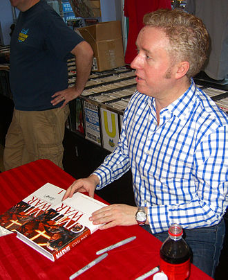 Civil War (comics) - Writer Mark Millar signing copies of the collectors edition of the main miniseries during an appearance at Midtown Comics in Manhattan
