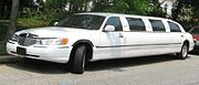 A Lincoln Town Car limousine