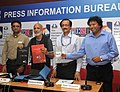 A.K. Bir unveiling the catalogues detailing the feature and non-feature programmes of IFFI-11, in Panaji, Goa. The Director, IFFI, Shri Shankar Mohan and the CEO of ESG, Shri Manoj Srivastava are also seen.jpg