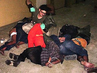 Abu Ghraib torture and prisoner abuse - Specialist Charles A. Graner punching handcuffed Iraqi prisoners