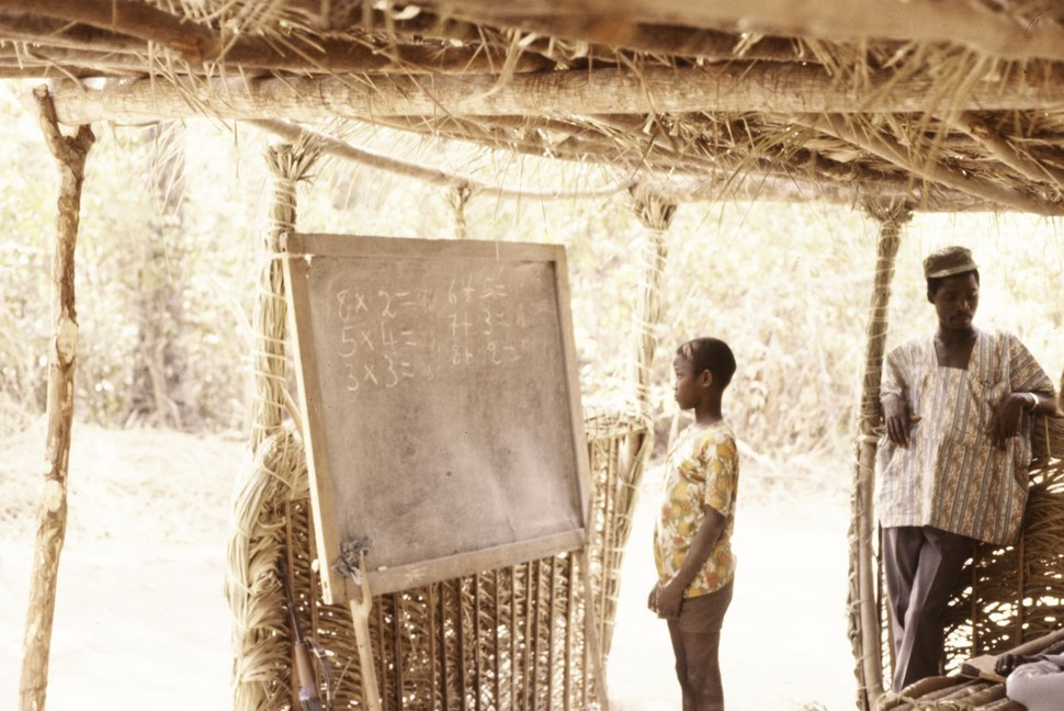 ASC Leiden - Coutinho Collection - C 05 - School in Sara, Guinea-Bissau - Boy in front of blackboard - 1974.tif
