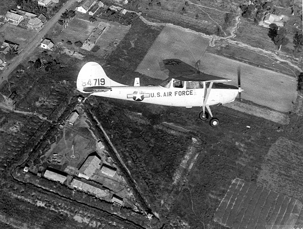 A Forward Air Controller O1-E Bird Dog aircraft is shown here in reconnaissance role near a Special Forces Camp in the Republic of Vietnam