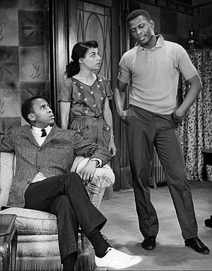 Sidney Poitier - A scene from the play A Raisin in the Sun. From left: Louis Gossett, Jr. as George Murchison, Ruby Dee as Ruth Younger and Poitier as Walter Younger.