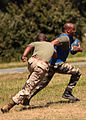 A U.S. Marine, left, with the ground combat element of Security Cooperation Task Force Africa Partnership Station 2012, runs after a French service member during a football game at Camp de Meucon, France 120723-M-JU449-431.jpg
