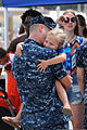 A U.S. Sailor assigned to the attack submarine USS Chicago (SSN 721) greets his family as the submarine returns to Apra Harbor, Guam, April 25, 2013, after completing its first mission as part of Commander 130425-N-LS794-333.jpg