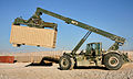 A U.S. Soldier with the 124th Engineer Company, South Carolina Army National Guard uses heavy equipment to move a freight container Oct. 17, 2013, at Multinational Base Tirin Kot, Afghanistan, as part of 131017-O-ZZ999-090-AU.jpg