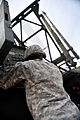 A U.S. Soldier with the 5th Battalion, 7th Air Defense Artillery Regiment ensures that launch pads are correctly positioned before testing Patriot missile communications during Austere Challenge 2012 in Beit 121024-F-QW942-182.jpg