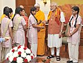 A group of girl students from the Vatsalya Gram Vrindavan tying Rakhi on the Prime Minister, Shri Narendra Modi's wrist, in New Delhi on August 31, 2015 (1).jpg