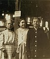 A group of girl workers in Greenabaum's Canneries, Seaford, Del. These girls gave their ages as 10, 13 and 13. The 10 year old girl is working her first season while the two girls of 13 are LOC nclc.00801 (cropped).jpg