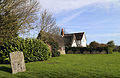 A listed cottage at Fyfield, Essex, England - Walker's Cottage, south-east from the church, with churchyard 02.jpg