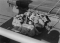 Aboard the German cargo ship MS Bernhard Howaldt, Arab port workers during their common lunch - 1958.png