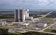 An aerial view of the Launch Complex 39 area shows the Vehicle Assembly Building (center), with the Launch Control Center on its right.
