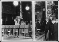 After 9 P.M., 7 year old Tommie Nooman demonstrating the advantages of the Ideal Necktie Form in store window on... - NARA - 523446.tif