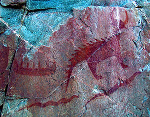 Anishinaabe - Pictograph of a canoe (top left), Michipeshu (top right), and two giant serpents (chignebikoogs), panel VIII, Agawa Rock, Lake Superior Provincial Park, Ontario, Canada