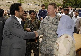 Ahmad Zia Massoud - Ahmad Zia Massoud as Vice President of Afghanistan shaking hands with a U.S. Provincial Reconstruction Team at the ceremony for a new road.
