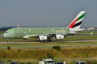 Aircraft livery - An Airbus A380 of Emirates with an unfinished livery. The various shades of green are from numerous primer coats.