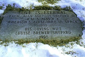 """A stone memorial plaque that reads: """"Love is Eternal – RADM Alan Bartlett Shepard Jr * US Navy * America's First man in Space 1998 – His loving wife Louise Brewer Shepard 1998"""""""