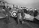 An Air Training Corps cadet secures his parachute, before an air experience flight in a de Havilland Tiger Moth at Biggin Hill, Kent, 4 January 1942. CH5030.jpg