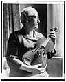 An expert on the violin, Dr. Apgar examines an instrument fashioned from an old telephone shelf. LCCN2002712241.jpg