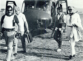 Armed Department of State security agents accompany U.S. Ambassador Deane Hinton in El Salvador circa 1982.png