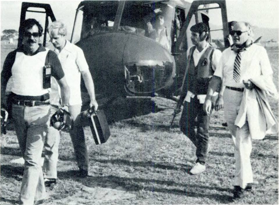 Armed Department of State security agents accompany U.S. Ambassador Deane Hinton in El Salvador circa 1982