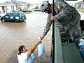 Army Spc. Timothy C. Berlanga of the Texas Army National Guard hands out a bag of ice.jpg