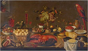 Artus Claessens - Large banquet still life with lobster, fruits, wine glasses, porcelain and pewter plates, birds, monkey, squirrel and cat