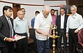"""Ashok Gajapathi Raju Pusapati lighting the lamp at the signing ceremony of the MoU for joint development and launch of the Post Graduate Diploma in """"AviationAirport Operations"""" between GMR Aviation Academy and Rajiv Gandhi.jpg"""