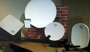 British Satellite Broadcasting - A photo of all three BSB dishes available, the squarial, a Sky dish for comparison, the round BSB dish, and the square BSB dish.