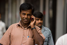 Bangalore guy with bindi on cellphone November 2011 -41.jpg