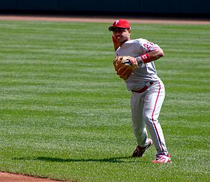 Phillies second baseman Plácido Polanco (now with the Detroit Tigers) ranges onto the outfield grass to field a ground ball