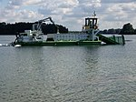 Bateau transporteur sur le Lac des Eaux Bleues.JPG