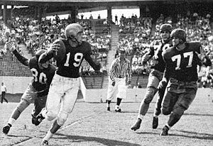 1952 Houston Cougars football team - Baylor quarterback Cotton Davidson hesitates during a pass play