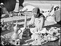 Bedouin life in Trans-Jordan. Pounding coffee to a rhythmic tune LOC matpc.15661.jpg