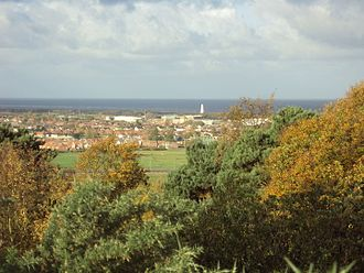 Bidston - The view north-west from the top of Bidston Hill, across Leasowe and Moreton. The white tower at the shore is Leasowe Lighthouse, with Liverpool Bay of the Irish Sea beyond.